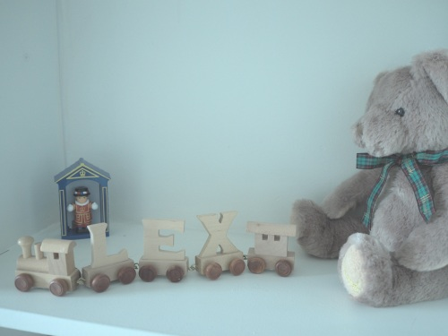 Personalised bits and bobs on his shelves
